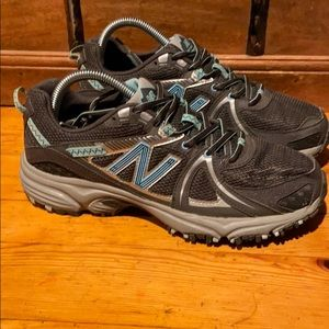 New Balance 501 gray & teal trail running shoes.